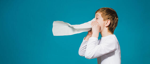 Kid sneezing possibly with influenza